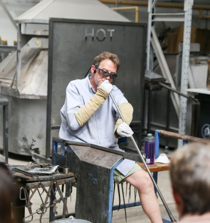 Photo of Adam Aaronson demonstrating glass blowing.